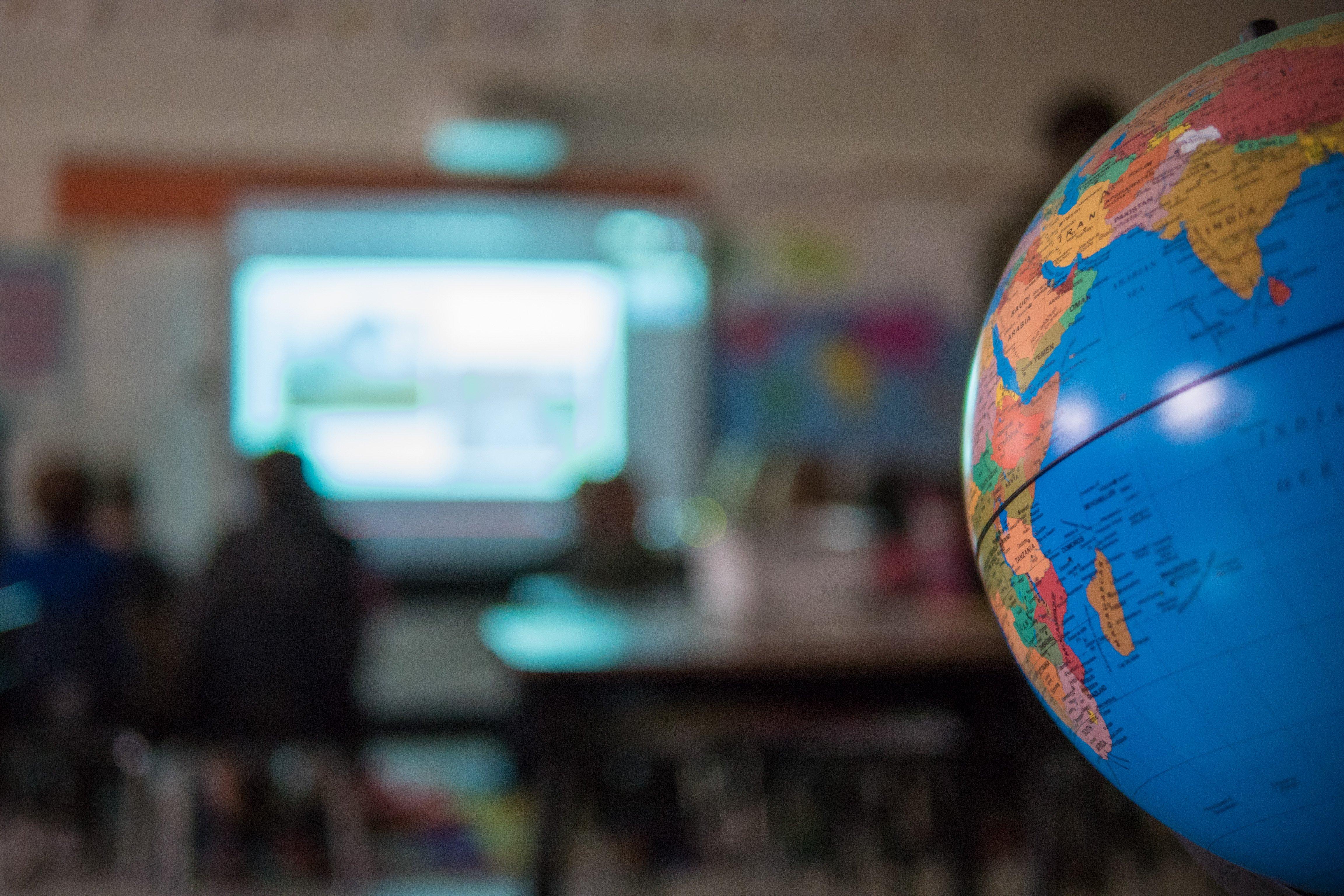 Globe overlooking a classroom
