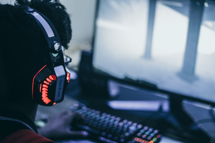 Male playing video game with headset on