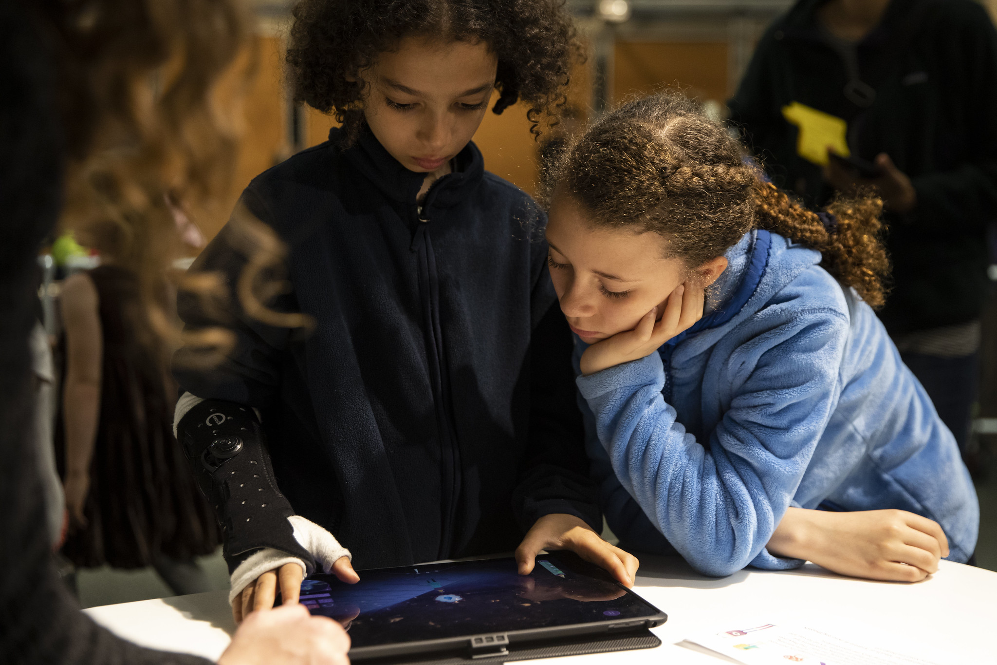 Two students looking at an iPad