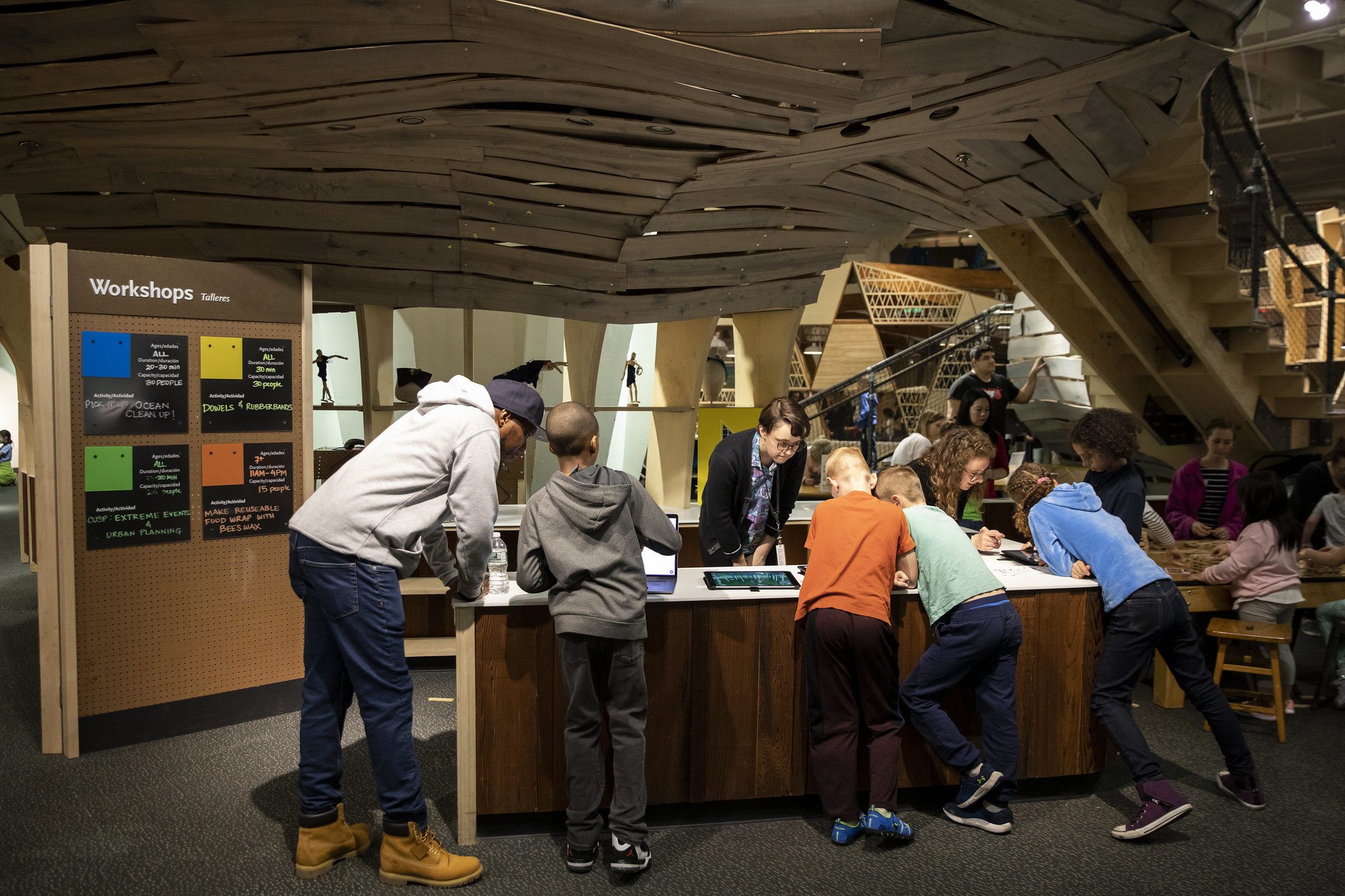Students at a table in a museum or makerspace
